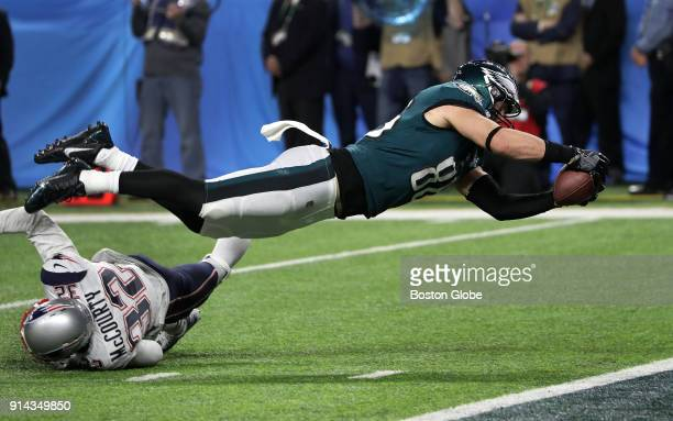 Philadelphia Eagles tight end Zach Ertz dives into the end zone for the game winning touchdown late in the fourth quarter The New England Patriots...