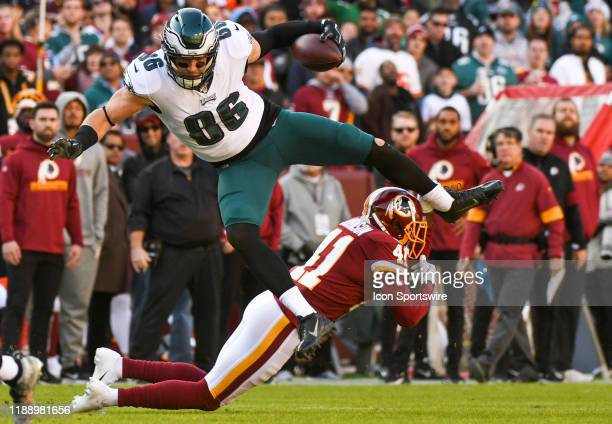 Philadelphia Eagles tight end Zach Ertz makes a reception and leaps over Washington Redskins defensive back Danny Johnson in action on December 15 at...
