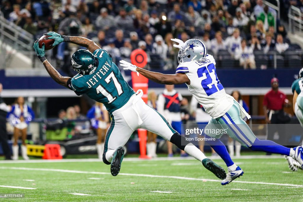 Philadelphia Eagles wide receiver Alshon Jeffery (17) stretches for the football over Dallas Cowboys defensive back Bene' Benwikere (23) during the game between the Dallas Cowboys and the Philadelphia Eagles on November 19, 2017 at AT&T Stadium in Arlington, Texas. The Eagles defeat the Cowboys 37-9.