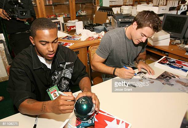 Philadelphia Eagles wide receiver DeSean Jackson and New England Patriots quarterback Kevin O'Connell sign autographs as part of the 2008 Reebok NFL...