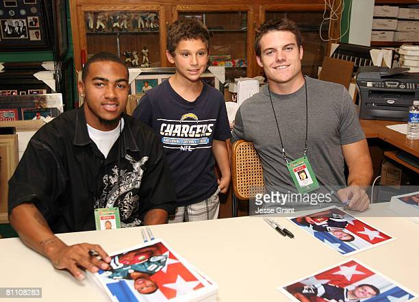 Philadelphia Eagles wide receiver DeSean Jackson and New England Patriots quarterback Kevin O'Connell poses with a fan as part of the 2008 Reebok NFL...