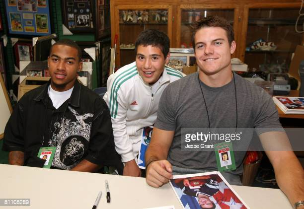 Philadelphia Eagles wide receiver DeSean Jackson and New England Patriots quarterback Kevin O'Connell poses witha fan as part of the 2008 Reebok NFL...