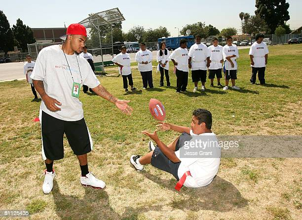 Philadelphia Eagles wide receiver DeSean Jackson with a student at the Children's Health Fund and NFL PLAYERS Rookie Premiere Youth Football Clinic...