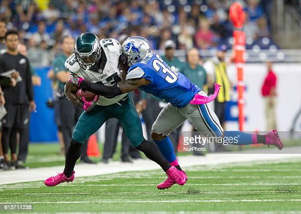 Philadelphia Eagles wide receiver Josh Huff runs with the ball against Detroit Lions strong safety Tavon Wilson during the first half of an NFL...