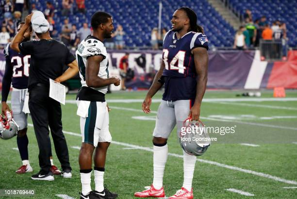 Philadelphia Eagles wide receiver Mike Wallace and New England Patriots wide receiver Cordarrelle Patterson after a preseason NFL game between the...