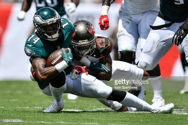 Philadelphia Eagles wide receiver Mike Wallace is tackled by Tampa Bay Buccaneers cornerback Ryan Smith and leaves the field with an injury during an...