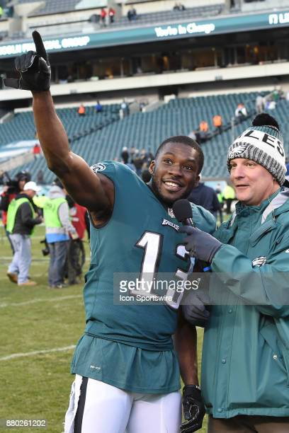 Philadelphia Eagles wide receiver Nelson Agholor points to the fans during an interview with Philadelphia Eagles Dave Spadaro during a NFL football...