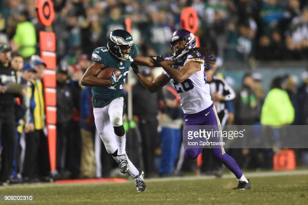 Philadelphia Eagles wide receiver Nelson Agholor straight arms Minnesota Vikings cornerback Trae Waynes during the NFC Championship game between the...