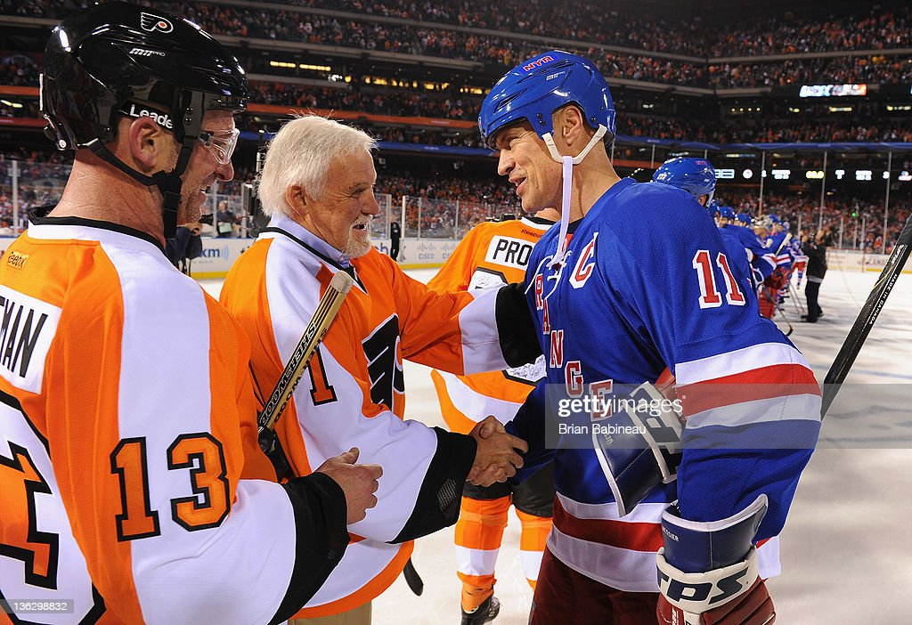 Philadelphia Flyers alumni goaltender Bernie Parent #1 shakes hands with New York Rangers alumni Mark Messier #11 after the Alumni game prior to the 2012 Bridgestone NHL Winter Classic at Citizens Bank Park on December 31, 2011 in Philadelphia, Pennsylvania.
