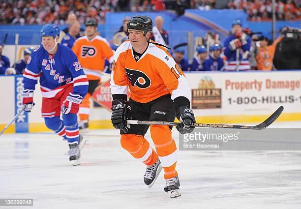 Philadelphia Flyers alumni John LeClair plays against the New York Rangers in the Alumni game prior to the 2012 Bridgestone NHL Winter Classic at...