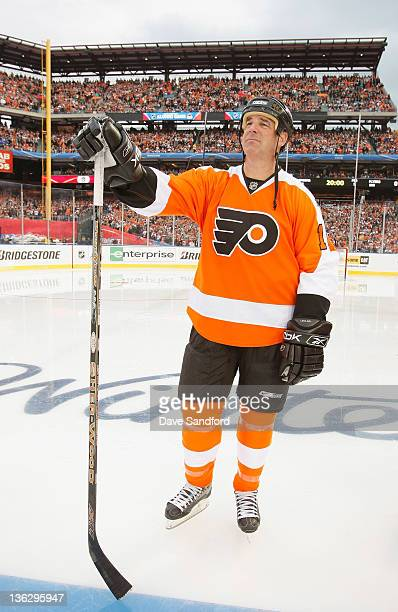 Philadelphia Flyers alumni John LeClair stands on the ice before the start of the Alumni game prior to the 2012 Bridgestone NHL Winter Classic at...