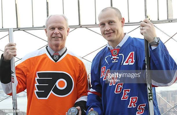 Philadelphia Flyers alumnus Mark Howe and New York Rangers alumnus Adam Graves visit The Empire State Building in celebration of the 2012 Bridgestone...