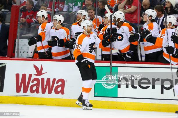 Philadelphia Flyers center Claude Giroux passes during the second period of the National Hockey League game between the New Jersey Devils and the...
