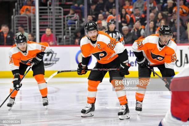 Philadelphia Flyers center Claude Giroux Philadelphia Flyers defenseman Shayne Gostisbehere and Philadelphia Flyers center Travis Konecny wait for...