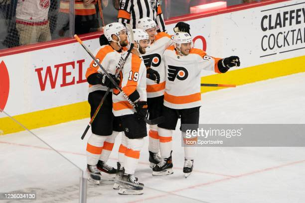 Philadelphia Flyers Center Derick Brassard and Philadelphia Flyers Defenseman Ivan Provorov and Philadelphia Flyers Right Wing Cam Atkinson celebrate...