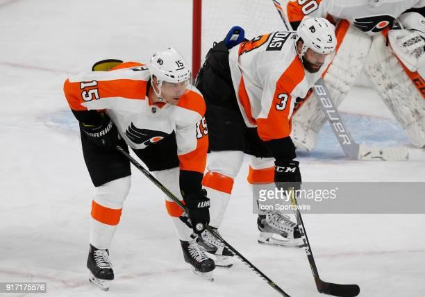 Philadelphia Flyers center Jori Lehtera and Philadelphia Flyers defenseman Radko Gudas prepare for a faceoff during the second period of a regular...