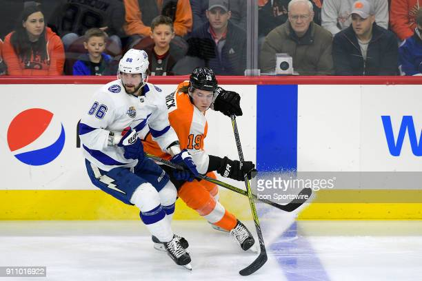 Philadelphia Flyers center Nolan Patrick and Tampa Bay Lightning right wing Nikita Kucherov fight for position during the NHL game between the Tampa...