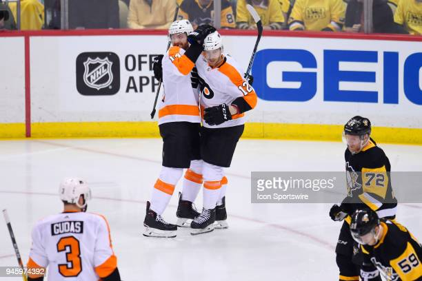 Philadelphia Flyers center Sean Couturier celebrates his goal with Philadelphia Flyers left wing Michael Raffl during the second period in Game Two...