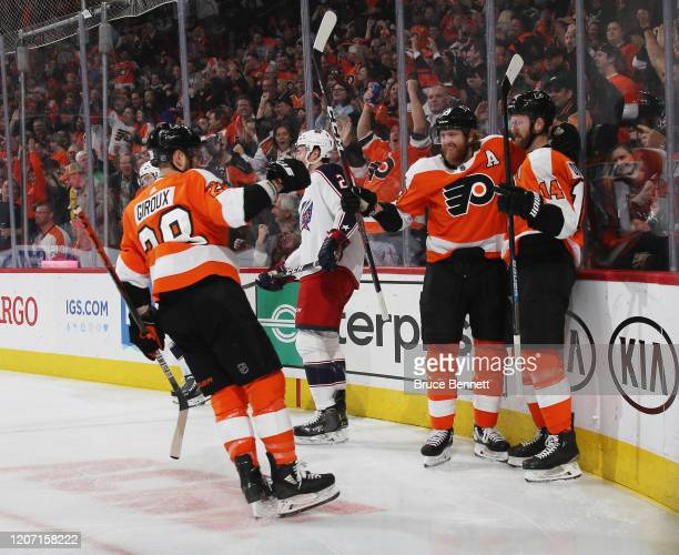 Philadelphia Flyers center Sean Couturier scores at 430 of the first period against the Columbus Blue Jackets and is joined by center Claude Giroux...