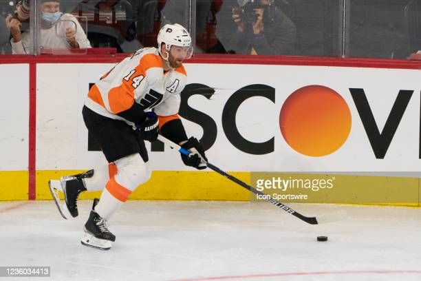 Philadelphia Flyers Center Sean Couturier skates with the puck during the second period of a National Hockey League game between the Boston Bruins...