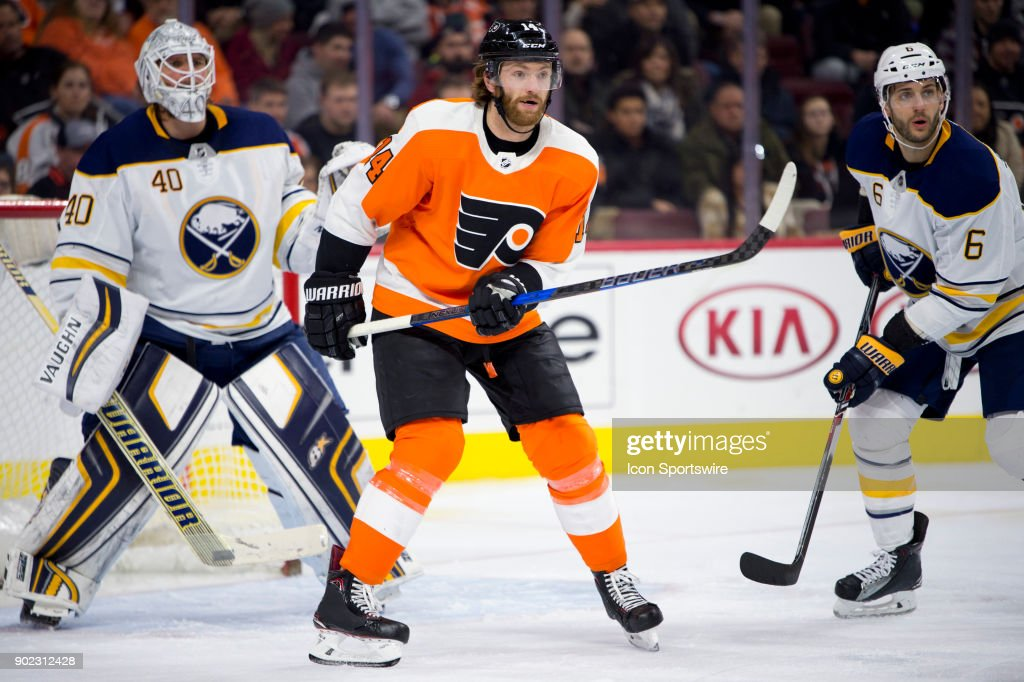Philadelphia Flyers Center Sean Couturier (14) stands in front of Buffalo Sabres Goalie Robin Lehner (40) in the third period during the game between the Buffalo Sabres and Philadelphia Flyers on January 07, 2018 at Wells Fargo Center in Philadelphia, PA.
