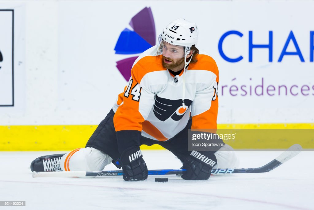 Philadelphia Flyers Center Sean Couturier (14) stretches during warm-up before National Hockey League action between the Philadelphia Flyers and Ottawa Senators on February 24, 2018, at Canadian Tire Centre in Ottawa, ON, Canada.