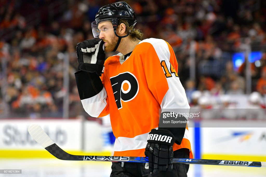 Philadelphia Flyers center Sean Couturier (14) waits for play to resume during the NHL game between the Montreal Canadiens and the Philadelphia Flyers on February 20, 2018 at the Wells Fargo Center in Philadelphia PA.