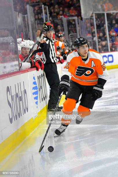 Philadelphia Flyers center Valtteri Filppula brings the puck up the ice along the boards during the NHL game between the Carolina Hurricanes and the...