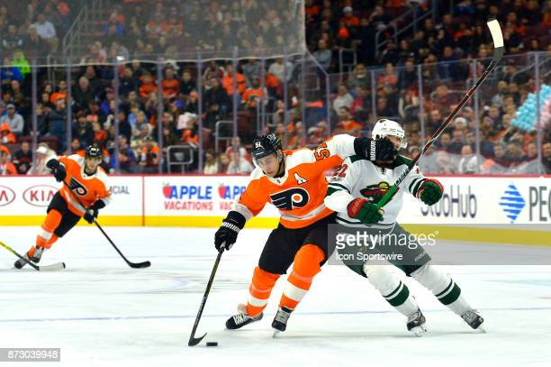 Philadelphia Flyers center Valtteri Filppula keeps Minnesota Wild right wing Nino Niederreiter out of his way with a glove to the face during the NHL...