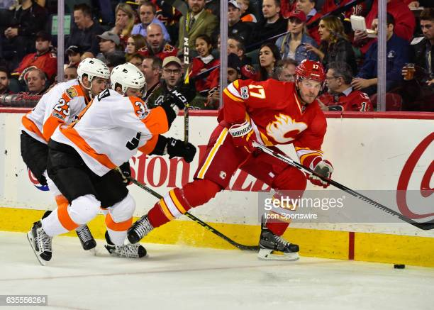 Philadelphia Flyers Defenceman Brandon Manning and Philadelphia Flyers Defenceman Radko Gudas chase Calgary Flames Left Wing Lance Bouma during a...