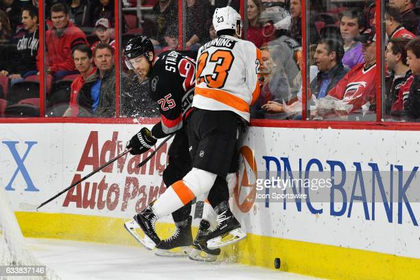 Philadelphia Flyers Defenceman Brandon Manning misses Carolina Hurricanes Right Wing Viktor Stalberg trying to make a hit along the boards in a game...