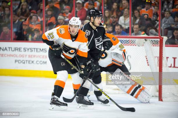 Philadelphia Flyers Defenceman Brandon Manning pushes Los Angeles Kings Right Wing Dustin Brown away from the net in the third period during the game...
