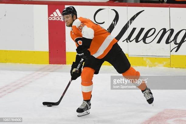 Philadelphia Flyers Defenceman Christian Folin passes the puck during the regular season game between the Colorado Avalanche and the Philadelphia...