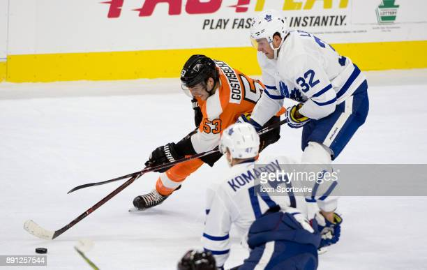 Philadelphia Flyers Defenceman Shayne Gostisbehere reaches past Toronto Maple Leafs Right Wing Josh Leivo for the puck in the first period during the...