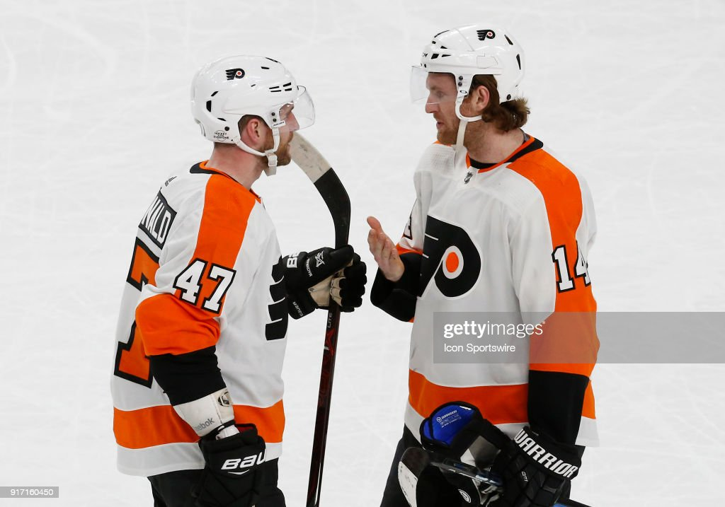 Philadelphia Flyers defenseman Andrew MacDonald (47) and Philadelphia Flyers center Sean Couturier (14) talk on the ice during the third period of a regular season NHL game between the Philadelphia Flyers and the Vegas Golden Knights at T-Mobile Arena Sunday, Feb. 11, 2018, in Las Vegas, NV. The Philadelphia Flyers would defeat the Vegas Golden Knights 4-1.