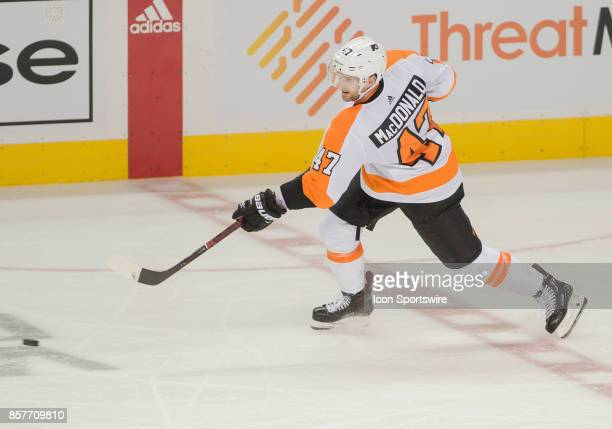 Philadelphia Flyers defenseman Andrew MacDonald passes the puck up ice during the regular season game between the San Jose Sharks and the...