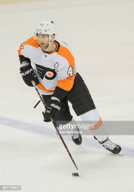 Philadelphia Flyers defenseman Andrew MacDonald skates with the puck towards the goal during the regular season game between the San Jose Sharks and...