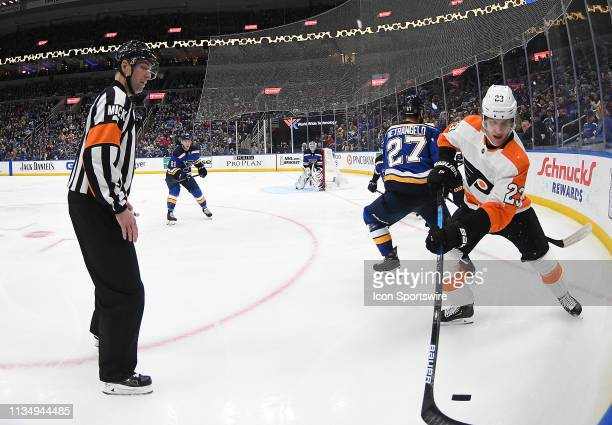 Philadelphia Flyers defenseman Brandon Manning controls the puck on the boards during a NHL game between the Philadelphia Flyers and the St Louis...