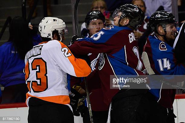 Philadelphia Flyers defenseman Brandon Manning fights with Colorado Avalanche center Mikhail Grigorenko during the second period at the Pepsi Center...