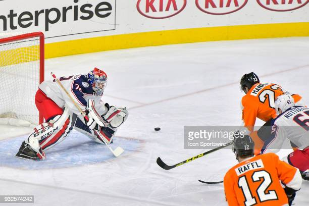 Philadelphia Flyers defenseman Brandon Manning firs his shot wide against Columbus Blue Jackets goaltender Sergei Bobrovsky during the NHL game...