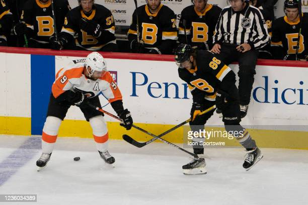 Philadelphia Flyers Defenseman Ivan Provorov and Boston Bruins Right Wing David Pastrnak battle for the puck during the second period of a National...