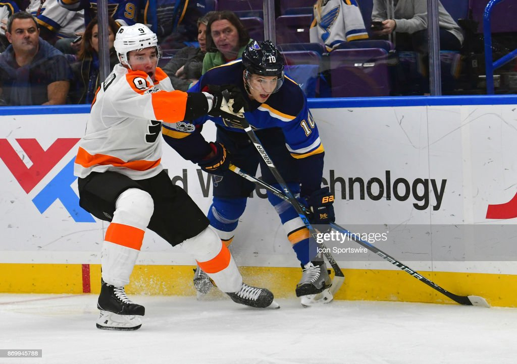 Philadelphia Flyers defenseman Ivan Provorov (9) and St. Louis Blues center Brayden Schenn (10) track a loose puck on the boards during a National Hockey League game between the Philadelphia Flyers and the St. Louis Blues on November 02, 2017, at Scottrade Center, St. Louis, MO.