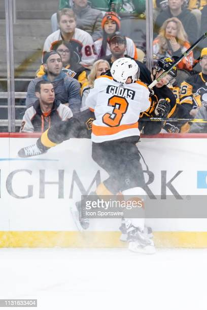 Philadelphia Flyers Defenseman Radko Gudas hits Pittsburgh Penguins Center Sidney Crosby into the boards during the second period in the NHL game...