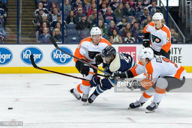 Philadelphia Flyers defenseman Robert Hagg and Philadelphia Flyers center Travis Konecny converge on Columbus Blue Jackets left wing Anthony Duclair...