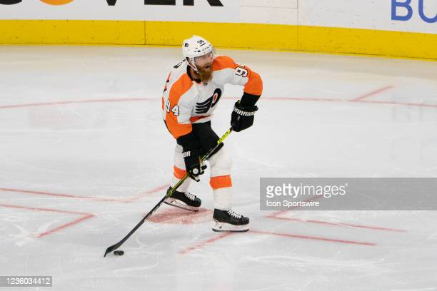Philadelphia Flyers Defenseman Ryan Ellis controls the puck during the second period of a National Hockey League game between the Boston Bruins and...