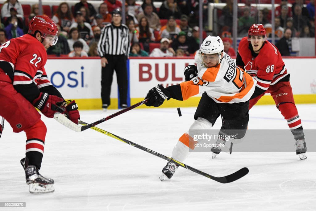 Philadelphia Flyers defenseman Shayne Gostisbehere (53) slaps at a flying puck with the puck during the game between the Philadelphia Flyers and the Carolina Hurricanes on March 17, 2018, at PNC Arena in Raleigh, NC.