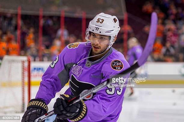 Philadelphia Flyers defenseman Shayne Gostisbehere warms up in his 'Hockey Fights Cancer' purple jersey before the game between the Detroit Red Wings...