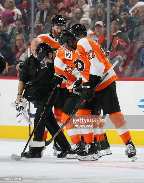 Philadelphia Flyers Director of Sports Medicine Jim McCrossin along with Sean Couturier Claude Giroux and Wayne Simmonds assist Shayne Gostisbehere...