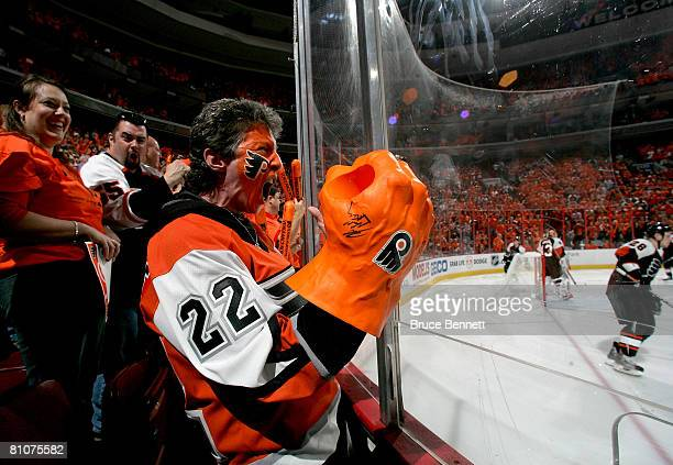 Philadelphia Flyers fan cheers on his team during warm ups before game three of the Eastern Conference Finals of the 2008 NHL Stanley Cup Playoffs...