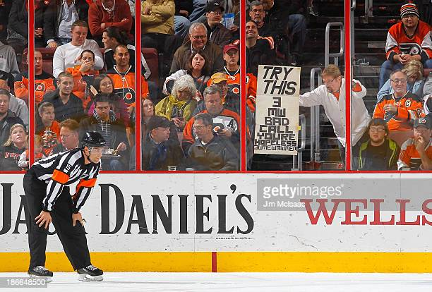 Philadelphia Flyers fan holds a banner in reference to referee Jean Hebert during a game against the Anaheim Ducks at Wells Fargo Center on October...